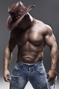 A muscular man in a cowboy hat